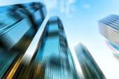 Skyscrapers in blurred motion. — Stock Photo