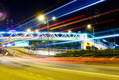 Traffic light trails and modern street — Fotografia Stock