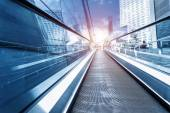 Fast escalator and sunbeam — Stock Photo