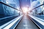 Fast escalator and sunbeam — Stock Photo
