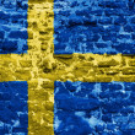 Swedish flag over old wall — Stock Photo #57812051