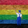 House painter covers wall with rainbow flag — Stock Photo #58508219