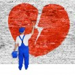 Symbol of broken love painted over brick wall by man — Stock Photo #59277483