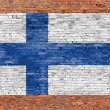 National flag of Finland painted over brick wall — Stock Photo #59993897