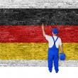 Painter covers brick wall with flag of Germany — Stock Photo #60139429