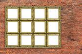 Huge golden frame over old brick wall — Stock Photo