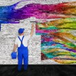 House painter fights with graffiti — Stock Photo #62171035
