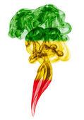 Smoke pillar colored in flag of reggae  — Stock Photo