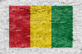 Reggae colors painted over brick wall — Stock Photo