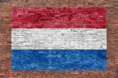 Flag of Netherlands painted over brick wall — Stock fotografie