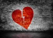 Shape of broken heart on brick wall — Stock Photo