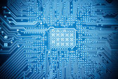 Blue computer circuit board texture — Photo