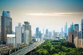 City traffic and skyline — Stock Photo