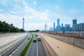 Tunnel with guangzhou skyline — Stock Photo