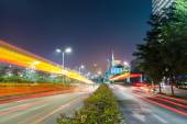 Dramatic light trails on the city road — Stock Photo