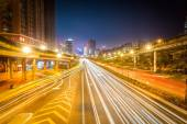 Light trails on city road at night — Stock Photo