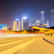 City road with modern buildings at night — Stock Photo #64034831