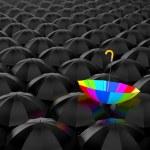 Rainbow umbrella on black umbrellas — Stock Photo #70148397