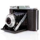 Old fashioned photo camera on white — Stock Photo