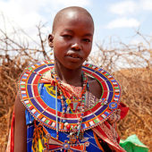 Masai woman is showing traditional clothes — Stock Photo
