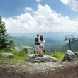 Couple look out over panoramic view from Mount Mansfield — Stock Photo #53752911