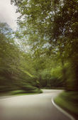 Speeding around mountain road — Stock Photo