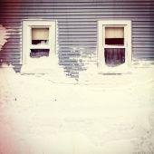 Snow mound under three windows — Stock Photo