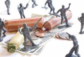 Army men defending American money — Stock Photo