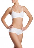 Slim tanned woman's body. — Stockfoto