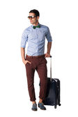 Elegant male with sunglasses,and travel suitcase — Stock Photo