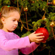 Adorable toddler girl holding decorative Christmas toy ball — Stock Photo #58943697