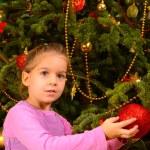 Adorable toddler girl holding decorative Christmas toy ball — Stock Photo #58943713