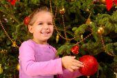 Adorable toddler girl holding decorative Christmas toy ball — Stock Photo