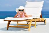 Toddler girl on sunbed — Stock Photo