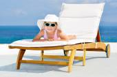 Adorable girl on sunbed — Stock Photo