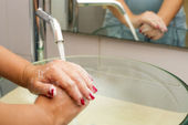 Hands washing with soap under running water — Stock Photo