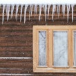Icicles on the window — Stock Photo #64971127
