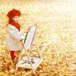 Child In Autumn Park Painting Picture On Easel. Creative Little Kid and Yellow Fall Leaves. Preschool Education and Early Development Concept — Stock Photo #52400765
