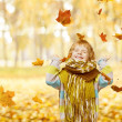 Child Portrait In Autumn Park, Smiling Little Kid Happy Playing With Falling Yellow Leaves — Stock Photo #52400769