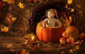 Autumn Baby Pumpkin. Little Kid Artistic Portrait In Children Woolen Hat, falling leaves — Stock Photo