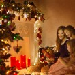 Christmas Family Woman Portrait, Mother And Daughters Celebrate Holiday, Opening Present Gift Box In Room Decorated By Xmas Tree and Candles Lights — Stok fotoğraf #57639127