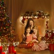 Christmas Family Woman Portrait, Mother And Daughters Celebrate Holiday, Opening Present Gift Box In Room Decorated By Xmas Tree and Candles Lights — Stok fotoğraf #57639135