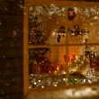 Christmas Window Holiday Home Lights, Room Decorated By Xmas Tree Candles Presents Gift, New Year Night, Snow And Frost — Stock Photo #57639795