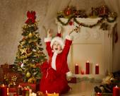 Christmas Kid Boy In Santa Hat And Bag, Child Happy Celebrate New Year, Room Decorated by Xmas Tree Present Gift Boxes and Candles — Stock Photo