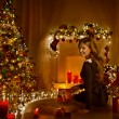 Christmas Woman Open Present Gift Box In Xmas Room, Holiday Tree Illuminated With Candles Lights — Stock Photo #58156447
