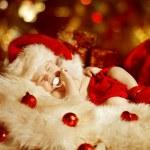 Christmas Baby, New Born Kid Sleeping As Xmas Gift In Santa Hat, Newborn Child Dreams In New Year Decoration — Stock Photo #58156801