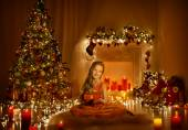 Christmas Child Girl Greeting Present Gift Box, Kid In Xmas Room With Candles Lights, Holiday Tree Illuminated By Garland — Stock Photo