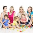 Children Group with Mothers Playing Toy Blocks. Little Kids Early Development. Baby Active Games, Isolated Over White Background — Stock Photo #67631895