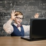 Kid Looking at Laptop, Child Notebook, Little Boy Mathematics Formula — Stock Photo #79651596