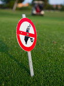 Forbidden sign post with golf bag — Stock Photo